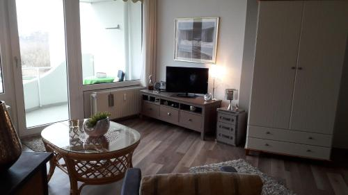 A television and/or entertainment center at Lord Nelson Cuxhaven