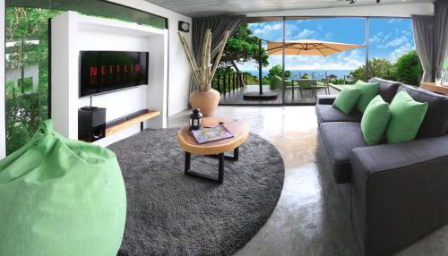 A seating area at Pahili Pool Villas Koh Tao