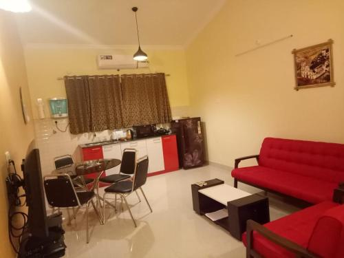 A seating area at 2BHK Pool view apartment near Vagator beach