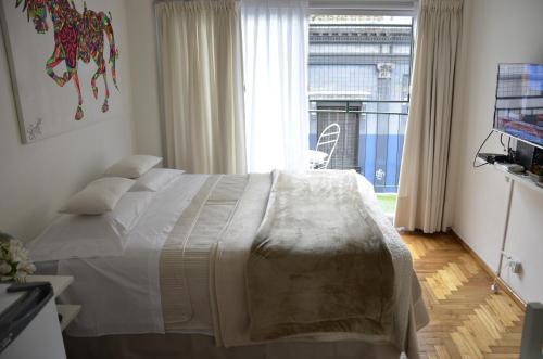 A bed or beds in a room at Departamento en Carlos Calvo