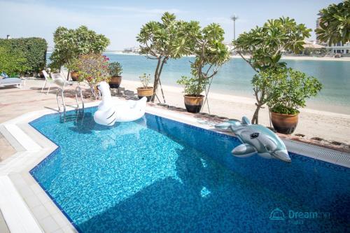 The swimming pool at or near Dream Inn - Royal Palm Beach Villa