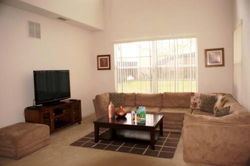 Uma área de estar em Ruby Red Holiday home 4711