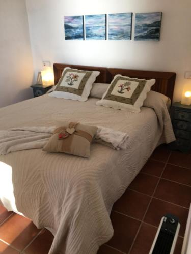 A bed or beds in a room at Apartamento Islas Medas