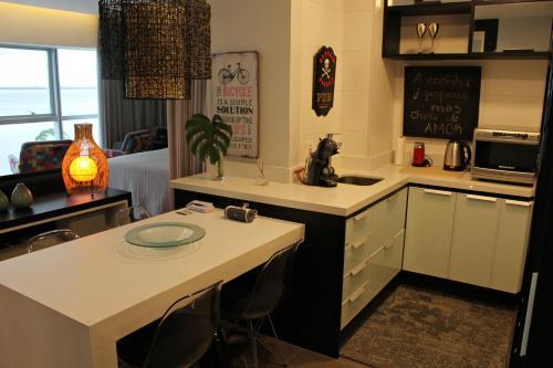 A kitchen or kitchenette at Loft Du Lac Barra