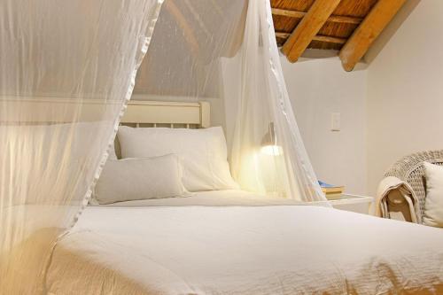 A bed or beds in a room at Noordhoek Paddocks Villa