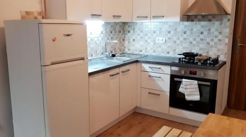 Кухня или мини-кухня в New cozy apartment