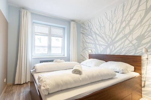 Tempat tidur dalam kamar di Modern Apartment in Quiet and Hipster Area by easyBNB