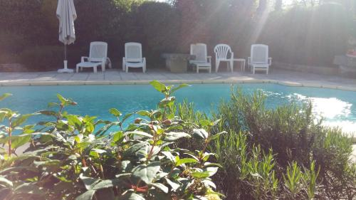 The swimming pool at or near Le Petit Village