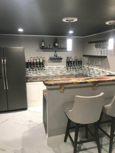 A Kitchen Or Kitchenette At Studio + Bar With Kegerator