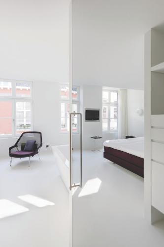 Двухъярусная кровать или двухъярусные кровати в номере Zenden Design Hotel