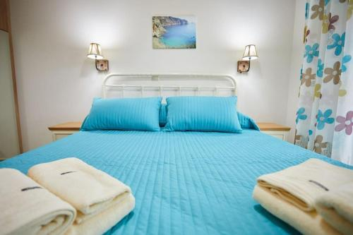 A bed or beds in a room at Chioni's Houses
