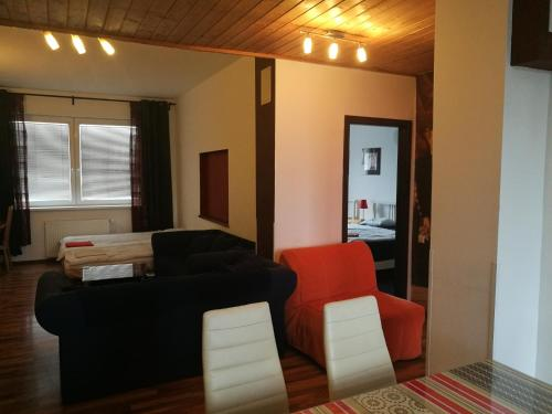 A seating area at Apartman Maximilian