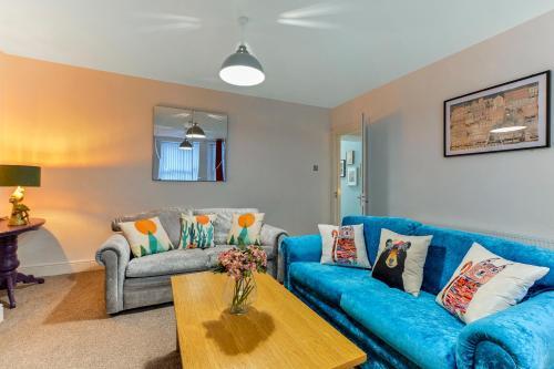 Ein Sitzbereich in der Unterkunft Crawford Square Apartment