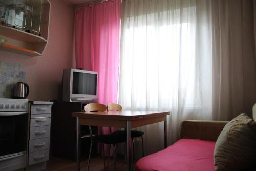 Телевизор и/или развлекательный центр в Апартаменты на Светлогорской 27