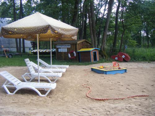 Children's play area at Ośrodek Wypoczynkowo-Turystyczny Perła Krutyni