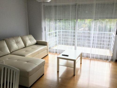 A seating area at Apartamento do Parque