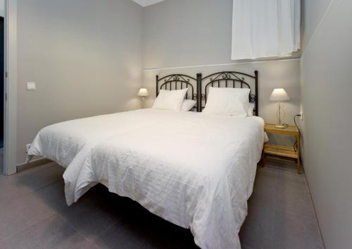 A bed or beds in a room at Amplio apartamento con terraza en zona muy tranquila