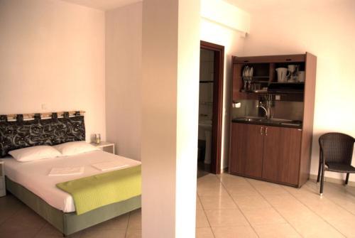 Un pat sau paturi într-o cameră la Inanthi