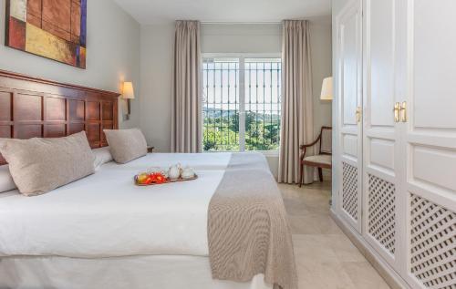 En eller flere senger på et rom på Ona Alanda Club Marbella