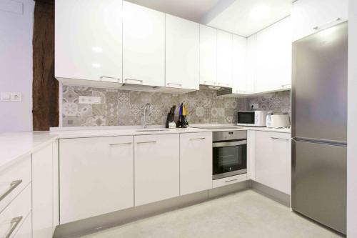 Una cocina o zona de cocina en The Rentals Collection | Verona