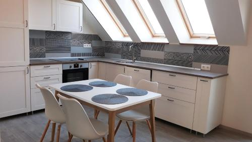 A kitchen or kitchenette at Cosy Holiday Apartment by Dora
