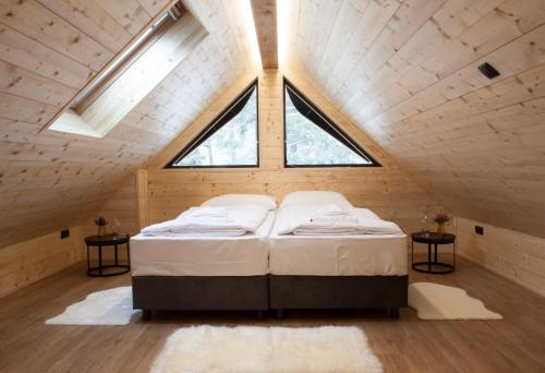 Postelja oz. postelje v sobi nastanitve Jasna Chalet Resort