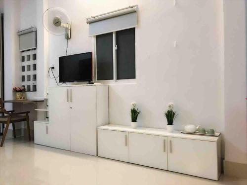Телевизор и/или развлекательный центр в Mon house 3 - 169/6A Vo Thi Sau Stress, D.3, HCMC