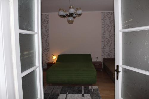 A bed or beds in a room at Kinga Vendégház