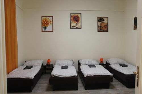 A bed or beds in a room at Budapest Centrum Apartment For You