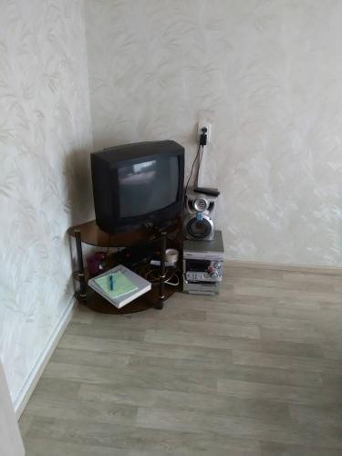 A television and/or entertainment center at 1-комнатная квартира на Белинского