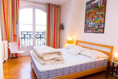 A bed or beds in a room at Appartement PARIS - Place Daumesnil