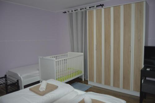 Postelja oz. postelje v sobi nastanitve Apartment Kancler