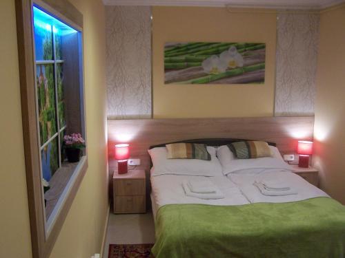 Orchidea Central Apartment 객실 침대