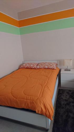 A bed or beds in a room at Ajloun apartment