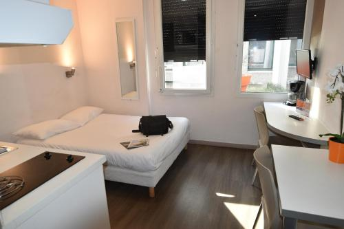 Un ou plusieurs lits dans un hébergement de l'établissement Montempô apparthotel Lyon