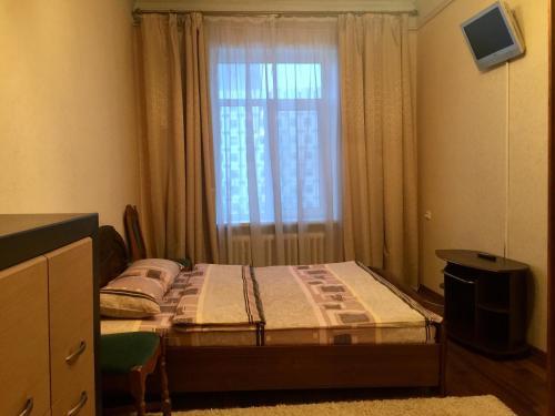 Uma cama ou camas num quarto em Apartment in the city center