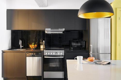 A kitchen or kitchenette at Maison Sainte-Thérèse By Maisons & co