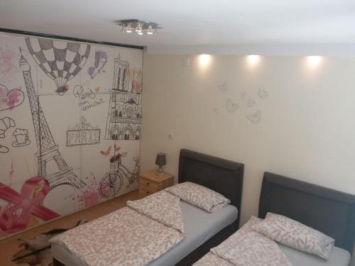 A bed or beds in a room at Apartment Ambrela