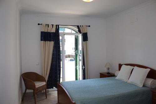 A bed or beds in a room at Apartment Tavira