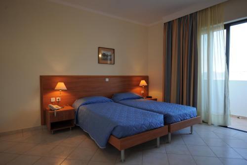 Ένα ή περισσότερα κρεβάτια σε δωμάτιο στο Golden View Studios