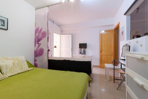 A bed or beds in a room at Casa cerca del campo y la ciudad