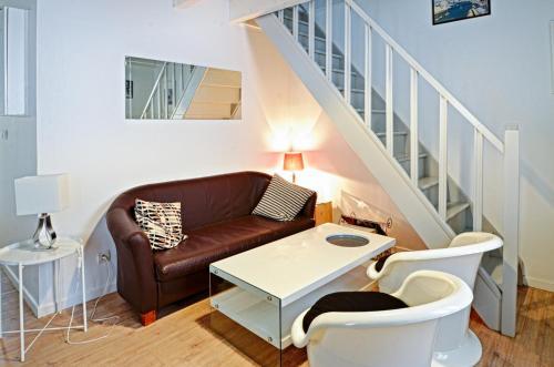 A seating area at Appartement du Palais Longchamps