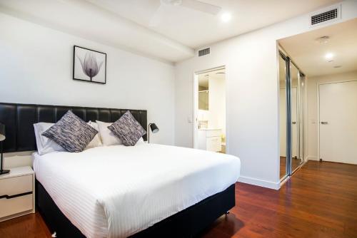 Ein Bett oder Betten in einem Zimmer der Unterkunft Arise Atlas Apartments