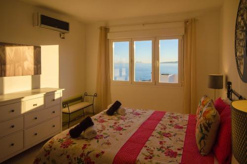 A bed or beds in a room at Apartamento con Vistas al Mar