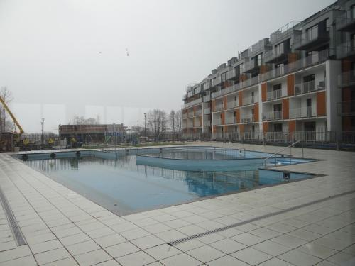 The swimming pool at or near Apartament 402 Kołobrzeg Podczele