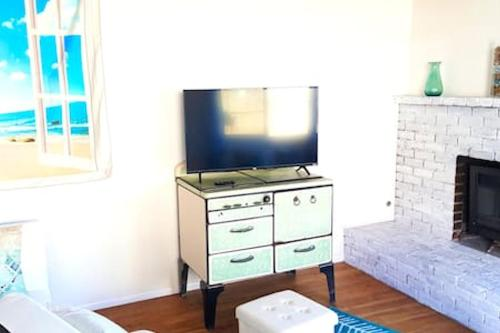 A television and/or entertainment center at Oceano: Short walk to beach, 4 br, 2 bath, private house! Across street from park & pond
