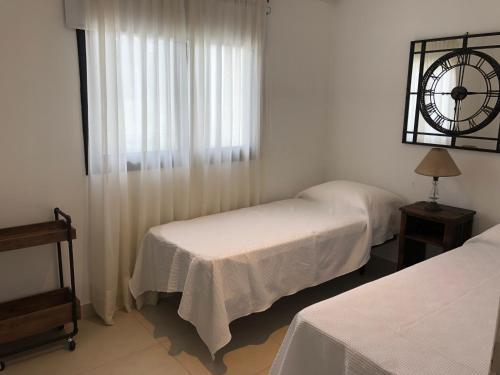 A bed or beds in a room at La Montaña