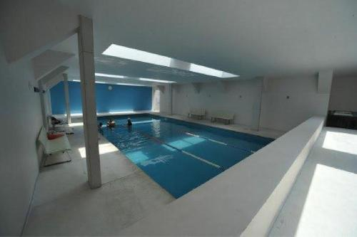 The swimming pool at or near Alameda Centro Historico Apartment