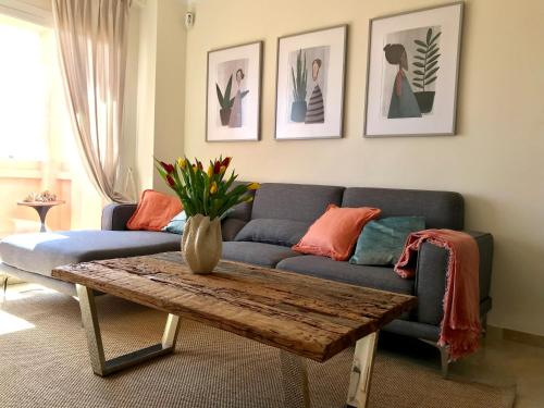 A seating area at El Faro - Amazing Duplex with Sea View , 3 Min Walks to the Beach
