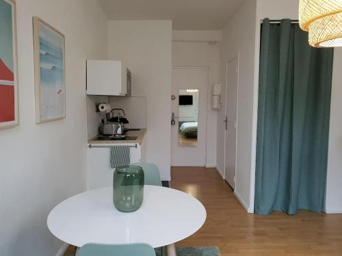 A kitchen or kitchenette at Grand Place Appart, Green